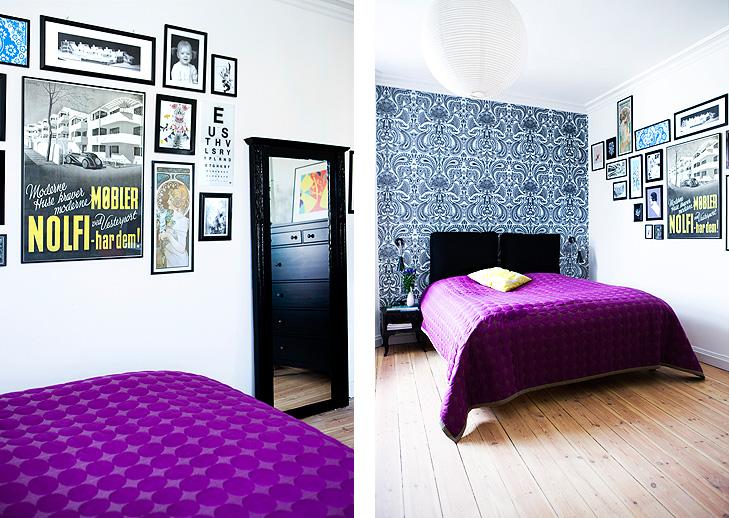 Indretning af soveværelse med billedvæg, spændende tapet og lilla sengetæppe